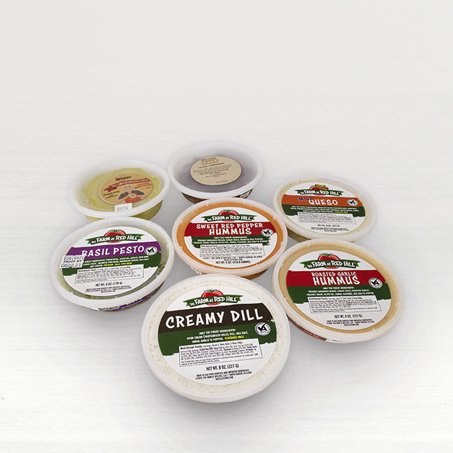A collection of dips and spreads offered by Seasonal Roots